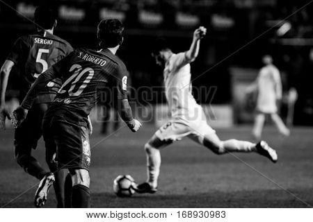 VILLARREAL, SPAIN - JANUARY 8: 5 Sergio, 20 Sergio Roberto during La Liga soccer match between Villarreal CF and FC Barcelona at Estadio de la Ceramica on January 8, 2016 in Villarreal, Spain