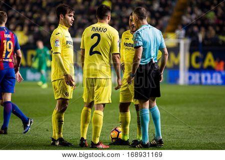 VILLARREAL, SPAIN - JANUARY 8: Referee Iglesias Villanueva (R) during La Liga soccer match between Villarreal CF and FC Barcelona at Estadio de la Ceramica on January 8, 2016 in Villarreal, Spain