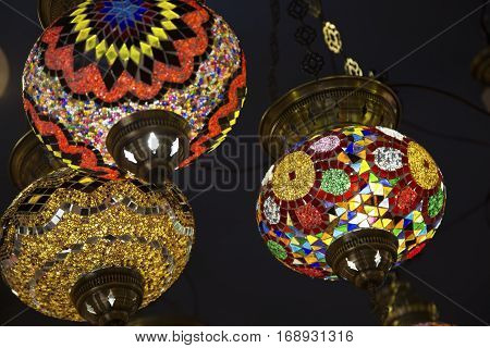 Colorful lightening Oriental lamps in a dark room