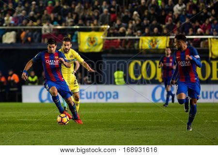 VILLARREAL, SPAIN - JANUARY 8: Luis Suarez with ball during La Liga soccer match between Villarreal CF and FC Barcelona at Estadio de la Ceramica on January 8, 2016 in Villarreal, Spain