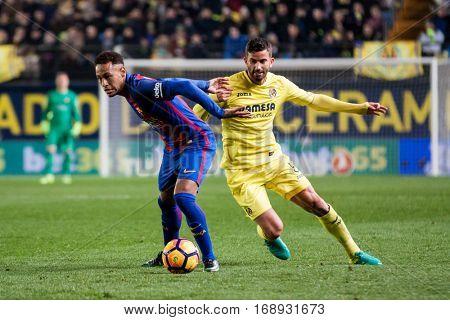 VILLARREAL, SPAIN - JANUARY 8: Neymar with ball and Musacchio during La Liga soccer match between Villarreal CF and FC Barcelona at Estadio de la Ceramica on January 8, 2016 in Villarreal, Spain
