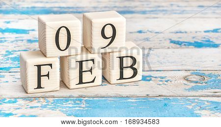 February 9Th. Wooden Cubes With Date Of 9 February On Old Blue Wooden Background.