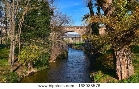 a view of the the Aude river and the Pont Vieux bridge in Carcassone, France