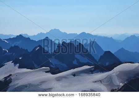Grassengrat Oberalpstock and other mountains. Morning scene on mount Titlis Switzerland.