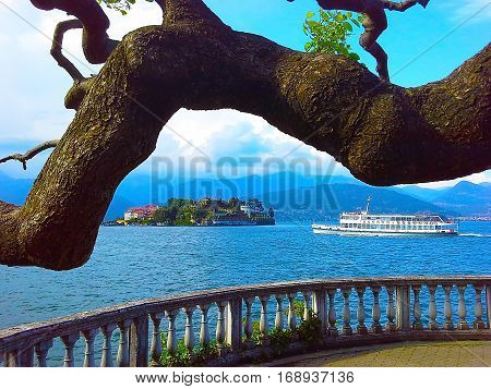 Panorama of Lake Maggiore and island Isola Bella with Alps mountains in background Piedmont Italy