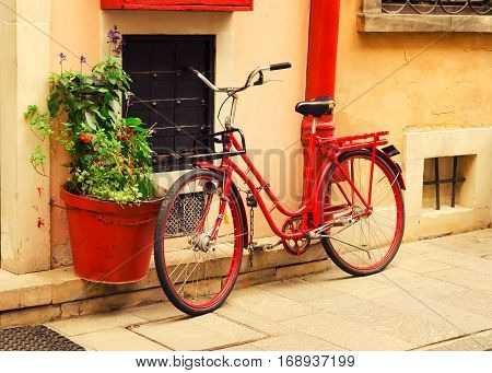 Red Bicycle on the street; Vintage photo