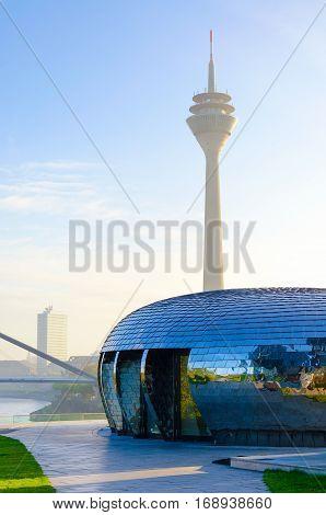 Dusseldorf Germany - October 29 2016: Rheinturm television tower and modern architecture building in Dusseldorf city in sunlight