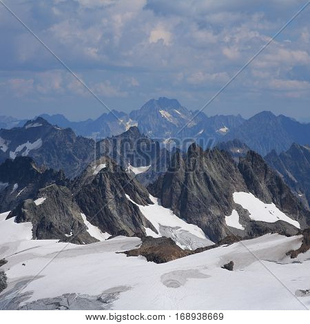 Rugged mountains in the Swiss Alps. View from mount Titlis popular travel destination in Switzerland. Mount Oberalpstock.
