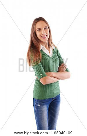 Full-length portrait of girl looking at camera, Toothy smiled teenage turned the body a little bit aside isolated in studio. Girl wearing white blouse underneath fitted dark olive green sweater