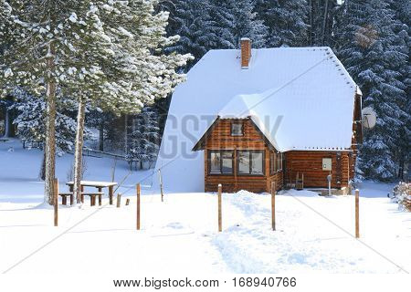 Log cabin on the mountain during winter
