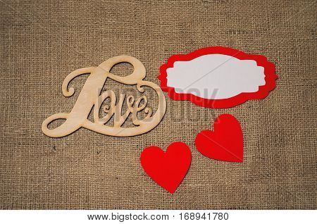Hearts flowers ribbons on a wooden light background