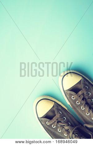 The vintage sneakers on colorful background.