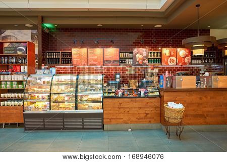 DUBAI - CIRCA NOVEMBER, 2016: a Starbucks cafe in Dubai International Airport. Starbucks Corporation is an American coffee company and coffeehouse chain.