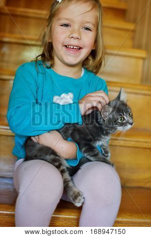 Happy Toddler Girl With Kitten