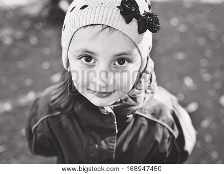 portrait of happy toddler girl wearing hat