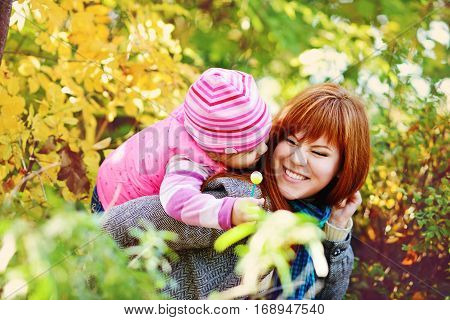 teen sister and baby sister having fun outdoors in fall time