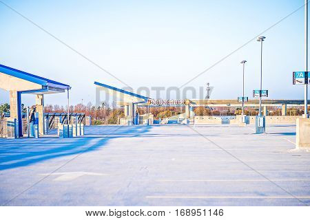 an airport parking and sunny blue skies