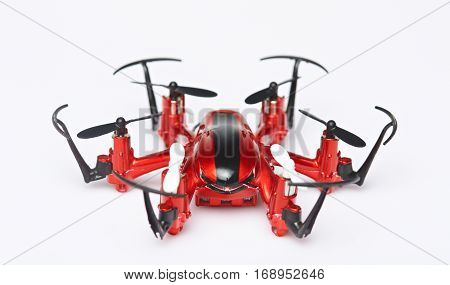 One red toy drone isolated on white background. Close up of drone front view