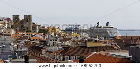 LISBON, PORTUGAL - September 26, 2016: View from the 12th century cathedral to the 21st century cruise ship in Lisbon Portugal.