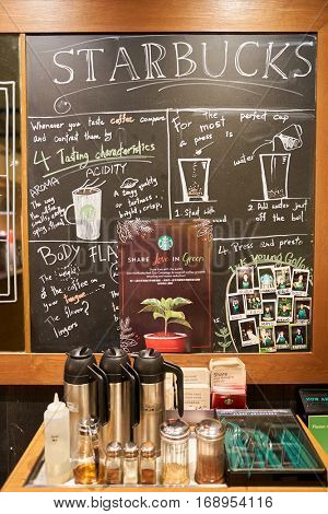 HONG KONG - CIRCA NOVEMBER, 2016: blackboard at Starbucks cafe in Hong Kong. Starbucks Corporation is an American coffee company and coffeehouse chain.