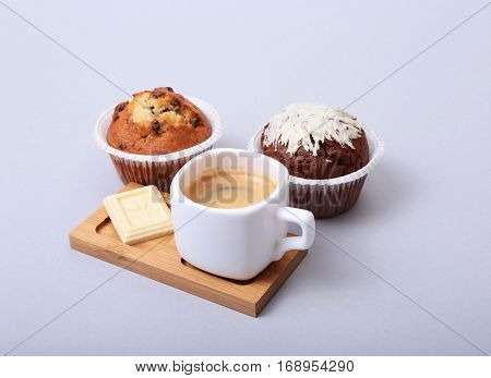 Classic style espresso shot with chip muffin and coffee beans on white background