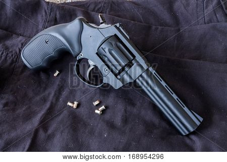 Revolver Flaubert on a dark background with bullets. Bullets.