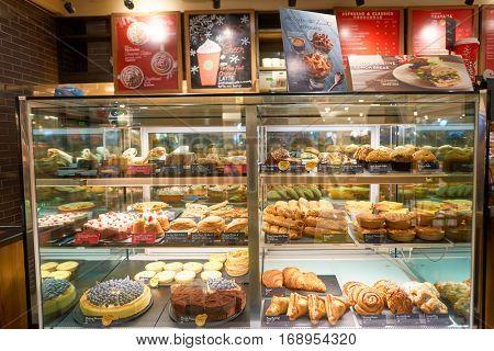 HONG KONG - CIRCA NOVEMBER, 2016: a Starbucks cafe in Hong Kong. Starbucks Corporation is an American coffee company and coffeehouse chain.