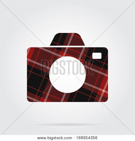 red black isolated tartan icon with white stripes - camera and shadow in front of a gray background