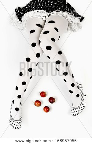 shaped legs dotted tights and four apples - conceptual