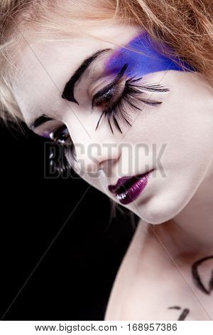 girls face with original make-up - fake eyelashes
