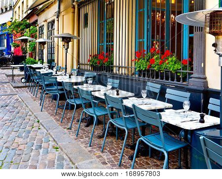 french restaurant - tables and chairs on the street - Paris France