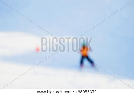 Little skier learning downhill alpine skiing. Blur image. Concepts Christmas, sport, healthy lifestyle, winter fun. Background, place text