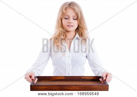 young beuatiful blond waitress with a tray looking down isolated