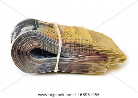 Bundle of Australian money isolated on white.  Side view.