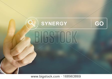 business hand clicking synergy button on search toolbar with vintage style effect