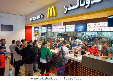 DUBAI, UAE - CIRCA NOVEMBER, 2016: counter service in a McDonald's restaurant at Dubai International Airport. McDonald's is an American hamburger and fast food restaurant chain.