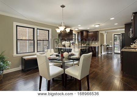 Kitchen in suburban home with large eating area.