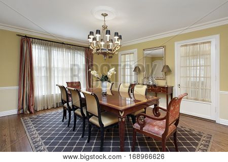 Dining room in suburban home with gold walls.