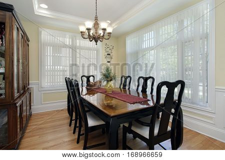Dining room with large buffet and black chairs.
