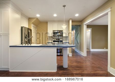 Kitchen in suburban home with blue island counter