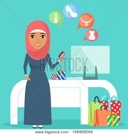 Arab Young girl makes purchases using your computer. Girl holding a credit card in hand. Purchases. Happy girl.