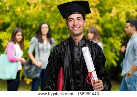 Young graduated student with his friends