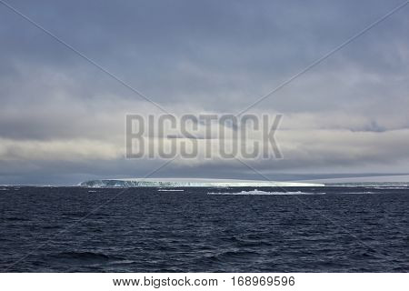 Island in Arctic covered with glacier - Franz Josef Land archipelago
