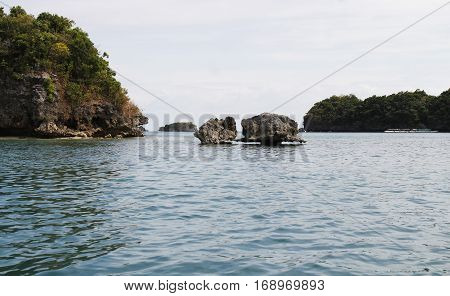 Tiny twin rock formations in between to islands