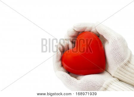 Red heart in white warm wool gloves isolated on white with clipping path