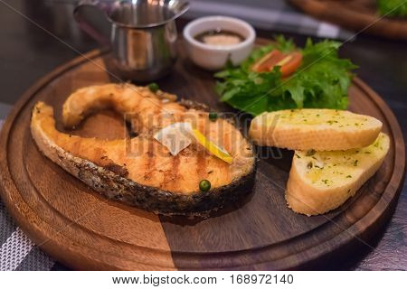 Grilled Salmon Steak With The Fresh Salad In White Plate.