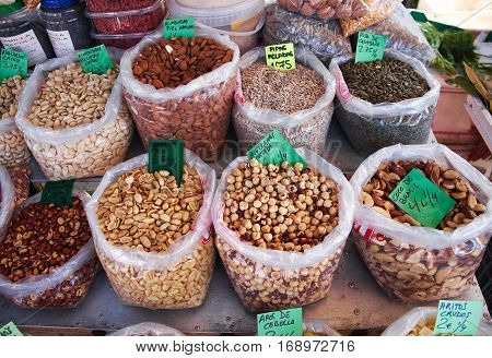 Many bags of various types of nuts for sale at Sunday market in Spain, Mercadillo de Campo de Guardamar.