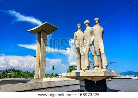RIO DE JANEIRO, BRAZIL - JANUARY 07, 2017: Concrete portal sculpture and granite statue honoring personnel of Brazil's land, sea, and air forces at National Monument to Dead of the Second World War