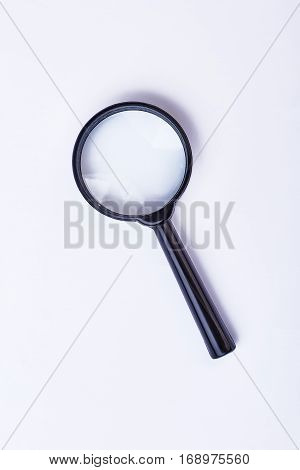 Magnifying glass isolated. Loupe with black handle.