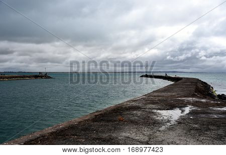 Portland beach Lee breakwater and harbour on a cloudy day. Portland is the oldest European settlement in Victoria state Australia located in Portland Bay.